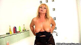 Mature with big tits masturbates in bathroom