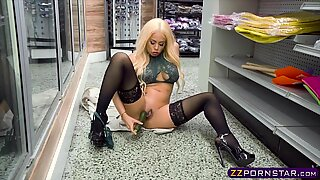 Busty blonde fucks with a security guard in a shop